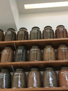 Photo of jars from the EJI Educational Center of jars of soil samples from Scipio's lynching site and several others.